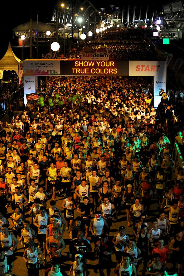 Some_10,000_runners_flagged_off_for_the_full_marathon_in_the_heart_of_the_city_at_the_F1_Pit_Building._