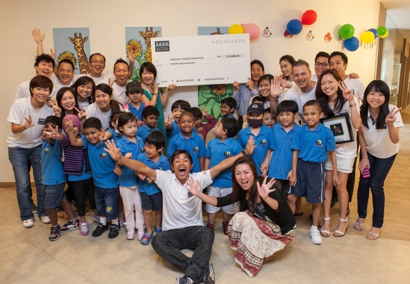 Visiting_Japanese_professional_rider_Takashi_Miyazawa_of_Team_Saxo-Tinkoff_presented_the_$15,000_cheque_for_CCF_raised_through_its_'Beat_the_Pro'_Challenge